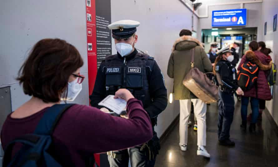German border police check passengers arriving on a flight from Spain.