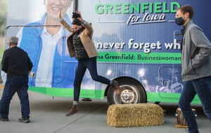Winterset, US Democratic Senate candidate Theresa Greenfield jumps off a hay bale after speaking at a socially distanced drive-in campaign event in Iowa. Greenfield had briefly suspended her campaign tour after learning staff members had come into contact with someone who tested positive for Covid-19. She has testing negative twice this week