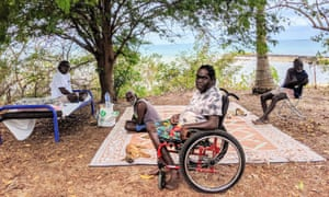 Djayak Munungurr (left), Ted Wanambi, NDIS participant Rex Munungurr and Mithili Munugurr out the front of their homes in the East Arnhem Land community of Garrthalala.