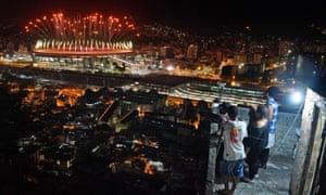 People watch fireworks in favela