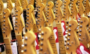Rows of new Fender Stratocaster guitars await shipment at its factory in Corona, California