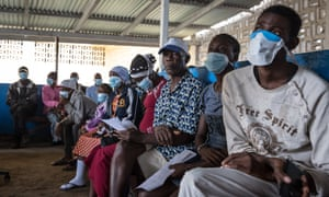 Patients wait to be tested for tuberculosis at a hospital in Liberia.