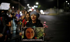 Women bearing a photograph of murdered Karla Turcios participate in a protest against femicides in San Salvador, El Salvador, on 29 March 2019.
