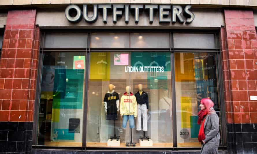 A shopper passes an Urban Outfitters shop in east London