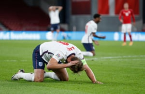 Kane reacts after a missed chance.
