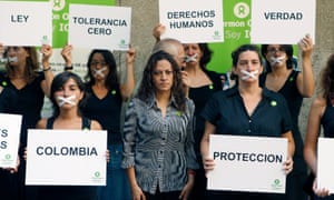 The Colombian journalist and victim Jineth Bedoya, center, and several others take part in a silent rally in 2009.