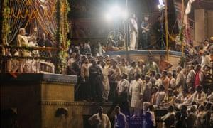 The prime minister, Narendra Modi, prays at one of the ghats in Varanasi in 2014.