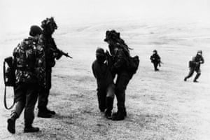 An Argentinian prisoner is blindfolded during the British advance to Port Stanley in the Falkland Islands.