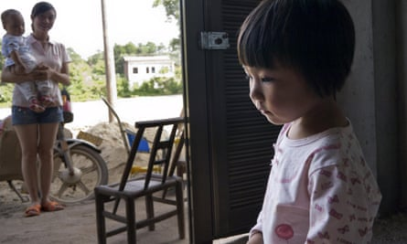 Two-year-old Xu Yilin, whose blood, according to her family, has been shown to have almost three times the national limit for lead exposure in children, in Dapu town, Hunan province.