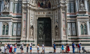 People queue outside Florence's Duomo.