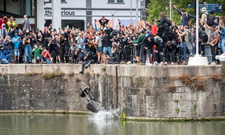 The statue of Edward Colston is thrown into Bristol harbour after protesters pulled it down.