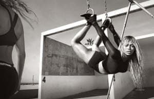 The hoop portrait is a nod to Helmut Newton's portrait of Daryl Hannah for Vanity Fair in 1984.