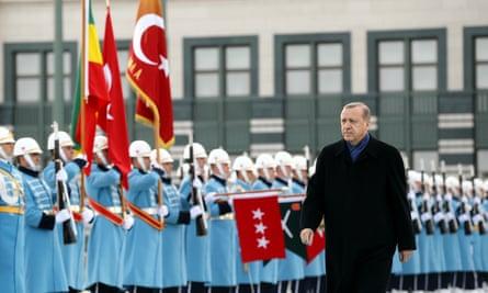 Turkish President Erdogan reviews a guard of honour