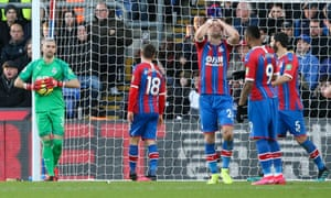 Gary Cahill of Crystal Palace holds his head in his hands after goalkeeper Vicente Guaita somehow manages to concede an own goal from a set piece.