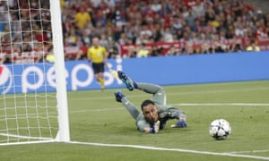 Real Madrid keeper Navas looks relived as Sadio Mane's shot hits the post