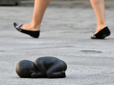 Iron Baby, 1999, by Antony Gormley, in the courtyard of the Royal Academy