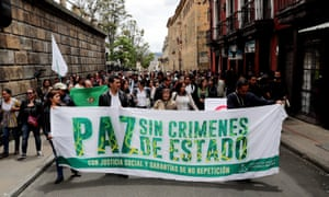 Human rights activists and social organizations march in Bogotá with a banner declaring 'Peace without state crimes' following the death of at least six coca farmers in Tumaco, in south-western Colombia.