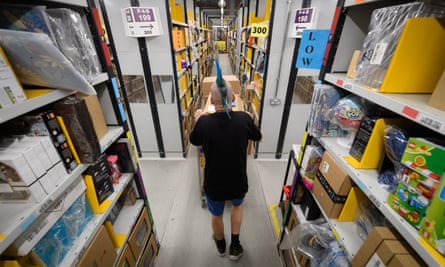 An Amazon employee prepares for Black Friday in its Hemel Hempstead centre.