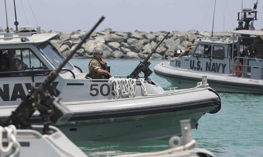 US Navy patrol boats carry journalists to see damaged oil tankers in the United Arab Emirates on Wednesday.
