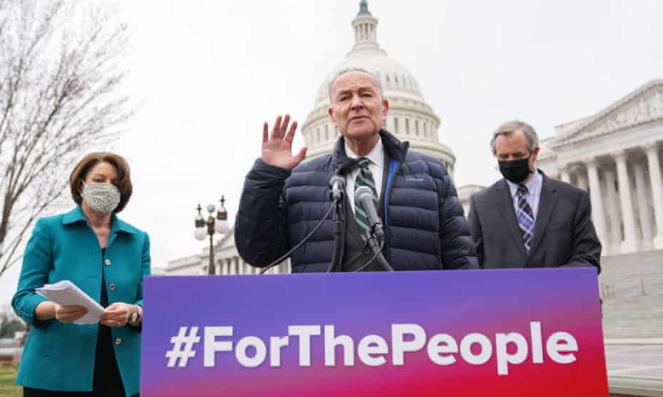 The Senate majority leader, Chuck Schumer, introduces the For the People Act alongside Senators Amy Klobuchar and Jeff Merkley on Capitol Hill on 17 March.