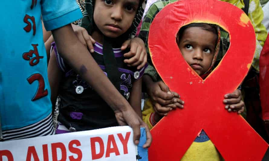 Children walk with activists in a torch light rally in Kolkata over World Aids Day. The UN has warned that the Asia-Pacific region is experiencing a rise in new HIV infections.