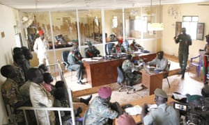 South Sudanese soldiers, left, at their trial in Juba