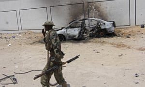 A Somali soldier near the wreckage of a car bomb in Mogadishu in April. There are several hundred US troops in Somalia helping the local military in its fight against al-Shabaab.