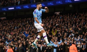 Riyad Mahrez celebrates after giving Manchester City the lead.