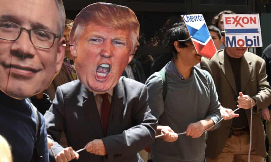 Protesters wear masks during a Trump Tower divestment 'teach-in' and tally in New York City on Tuesday.