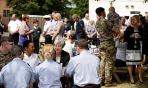 Theresa May meeting military service personnel and their families during a visit to the Permanent Joint Headquarters (PJHQ) and Nato's maritime headquarters in Northwood this morning.