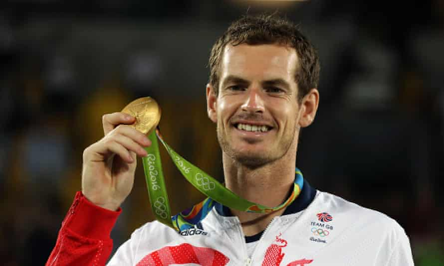 Andy Murray poses with his gold medal during the victory ceremony at the 2016 Olympics in Rio. It was his second successive title.