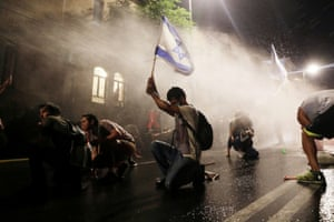 Jerusalem, Israel: Police use a water cannon as Israelis protest against the prime minister, Benjamin Netanyahu. Protesters demand that the embattled Israeli leader resign as he faces trial on corruption charges and grapples with a deepening coronavirus crisis.