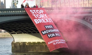 Campaigners lower a banner off Westminster Bridge before the People's Vote march in October 2018.