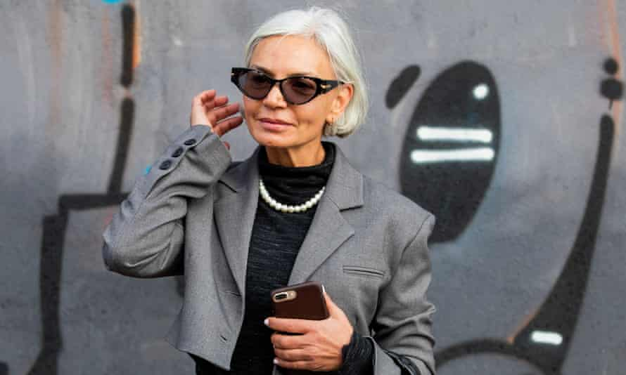 Grece Ghanem in grey jacket and pearls