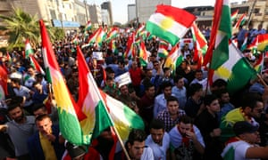 Iraqi Kurds wave flags of Iraqi Kurdistan and shout slogans during a demonstration outside the UN Office in Erbil.