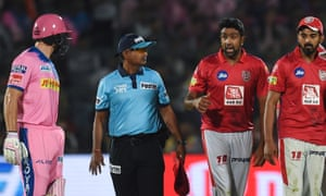 Ravi Ashwin (second right) exchanges words with Rajasthan Royals' Jos Buttler (left) after the Kings XI Punjab bowler got him out with a Mankad during their 2019 Indian Premier League match.