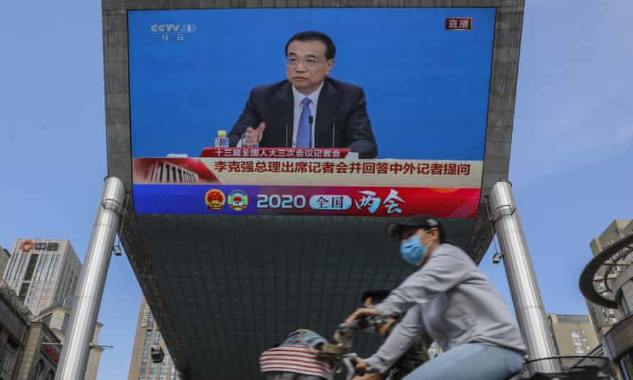 A screen showing Chinese premier Li Keqiang speaking at a press conference after the closing ceremony of the National People's Congress.