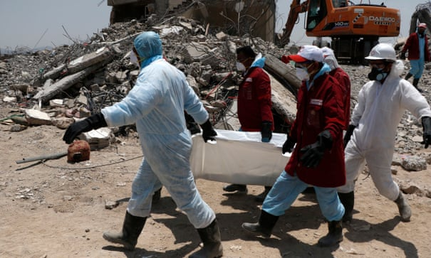 Medics carry the body of a victims allegedly killed in airstrikes carried out by warplanes of the Saudi-led coalition on 1 September.