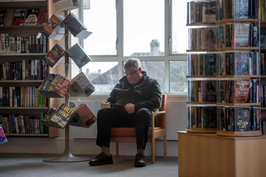 A man reads in Highworth library