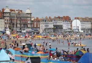People in the sea on Weymouth beach