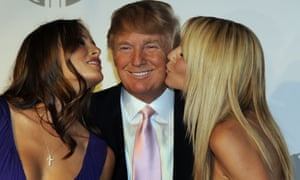 "(FILES) This file photo taken on June 24, 2008 shows Melania Trump, Donald Trump and model Heidi Klum posing at party at the Park Avenue Plaza in New York June 23, 2008 to introduce the Trump International Hotel & Tower Dubai. Donald Trump said on November 9, 2016 he would bind the nation's deep wounds and be a president ""for all Americans,"" as he praised his defeated rival Hillary Clinton for her years of public service. / AFP PHOTO / TIMOTHY A. CLARYTIMOTHY A. CLARY/AFP/Getty Images"