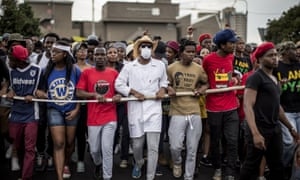 Demonstrators march through the campus of the University of the Witwatersrand in Johannesburg