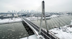 Aerial picture taken by a drone shows a snowy panorama of Warsaw and the Vistula River with Swietokrzyski Bridge in Poland.