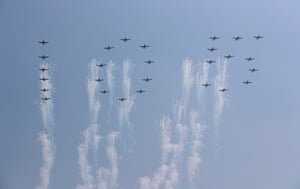 Planes forming the numbers 105 fly past during a parade for the 'Day of the Sun' festival