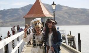 Bride Marianna Fenn and bridegroom Toby Ricketts stand on a jetty in Akaroa harbor, New Zealand, Saturday April 16, 2016.