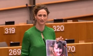 Lynn Boylan addresses the European parliament holding a picture of Mary Boyle.