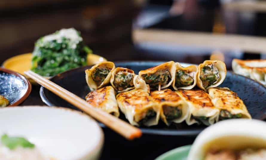 A plate of dumplings with a chopstick on the dise at ShanDong MaMa, Melbourne, Australia.