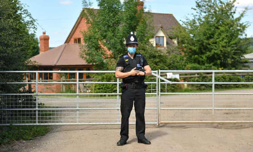 Police officer outside the farm
