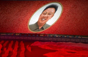 "A portrait of the late North Korean leader Kim Jong Il is formed during the ""Glorious Country"" mass games pert of the 70th anniversary events."