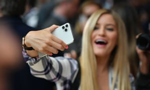 A woman tries out a new Apple 11 Pro during alaunch event at Apple's headquarters in Cupertino, California